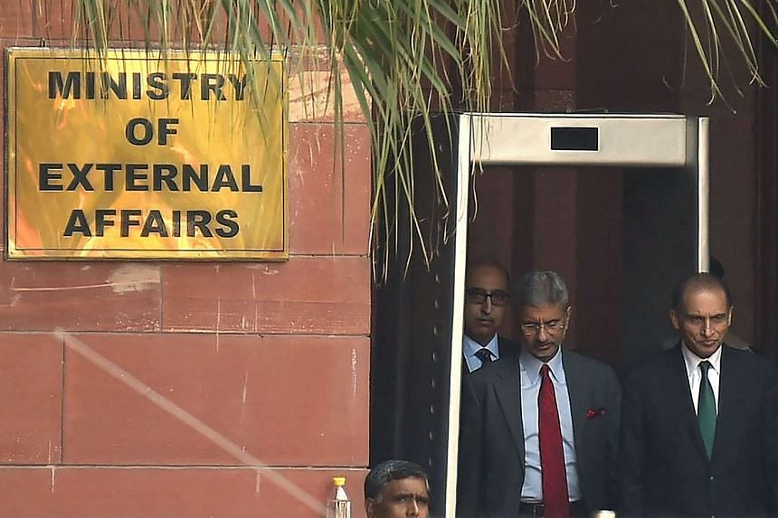 Indian Foreign Secretary S. Jaishankar (left) walks with Pakistan Foreign Secretary Aizaz Ahmad Chaudhry (right) after a meeting at The Ministry of External Affairs in New Delhi, on April 26, 2016.