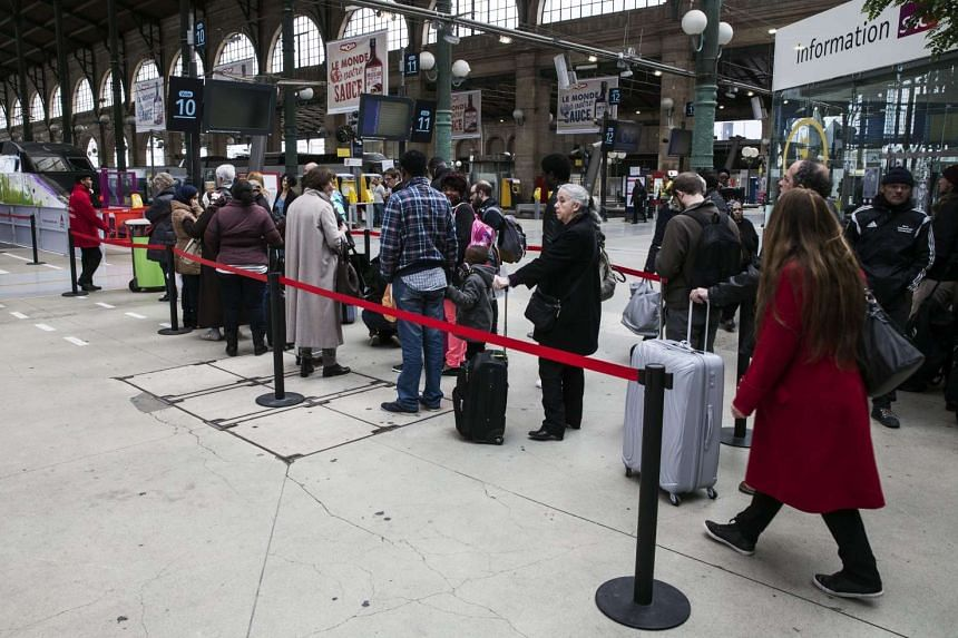 Passengers wait in line to access the trains during a strike at Gare du Nord in Paris, France, on April 26, 2016.