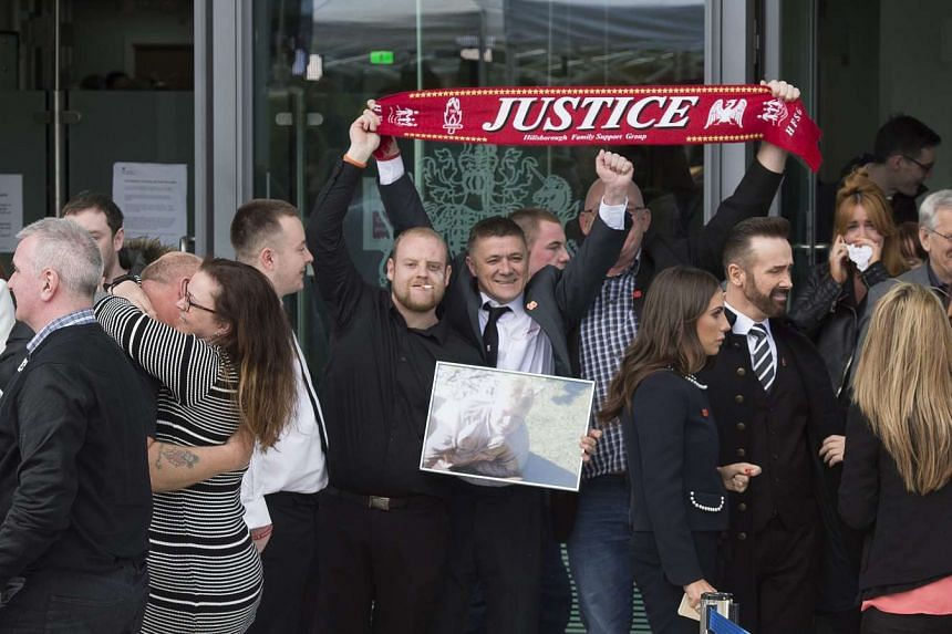 Families of the victims of the 1989 Hillsborough disaster coming out after the inquest at the Coroners Court in Warrington, Britain, on April 26, 2016.