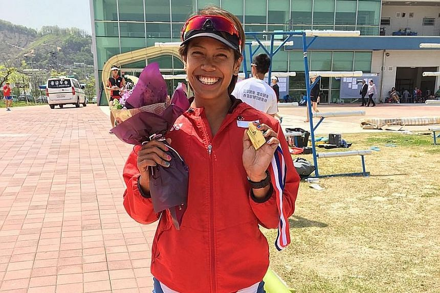 National rower Saiyidah Aisyah with her gold medal after winning the B final of the 2,000m women's single sculls at the Fisa Asia and Oceania Olympic Qualification Regatta to secure her Olympics berth.