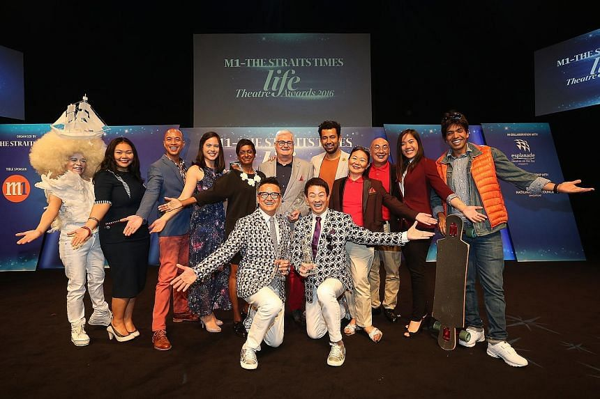 Co-directors (kneeling, from left) Glen Goei and Ivan Heng with the cast of Wild Rice's Hotel, which won four prizes at the M1-The Straits Times Life Theatre Awards yesterday. It won the awards for Best Ensemble, Production of the Year, Best Original