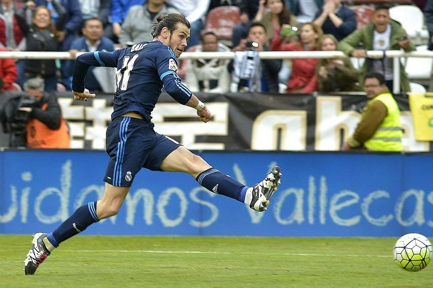 Gareth Bale scoring Real Madrid's third goal against Rayo Vallecano on April 23. The Welshman masterminded the fightback from 0-2 down.