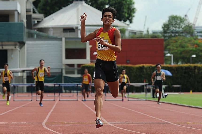 Hwa Chong Institution's Ow Yeong Wei Bin took gold in In the A Div 400m hurdles, beating the previous meet record set by his brother.