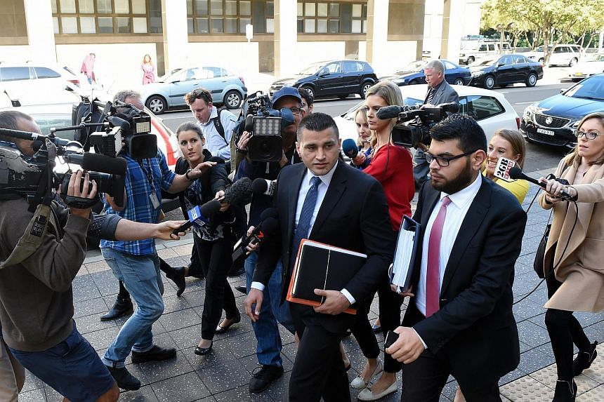 Lawyer Zemarai Khatiz (centre), who is representing the Australian teenager accused of planning the attack, leaving the Parramatta Children's Court in Sydney on April 26, 2016.