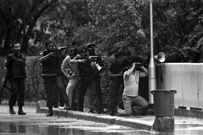 Members of the Police Tactical Team outside retired businessman Robert Tay's bungalow at Andrew Road on July 23, 1983. Mr Tay, his wife and their Filipino maid were found murdered.