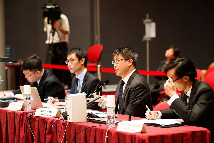SMU law professor Jack Lee (second from right) speaking at the public hearing.