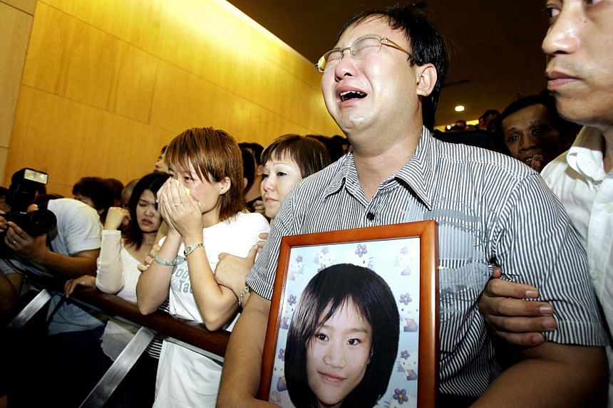 Huang Na's parents had to be supported at the Mandai Crematorium as they watched their daughter's coffin roll into the furnace. The Primary 2 student was killed in a storeroom at the Pasir Panjang Wholesale Centre.