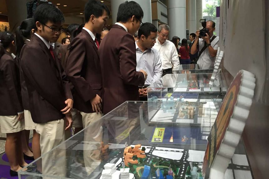 Students from Hwa Chong Institution presenting their urban design for Paya Lebar Central to Mr Desmond Lee, Senior Minister of State for National Development and Home Affairs, on Tuesday (April 26).