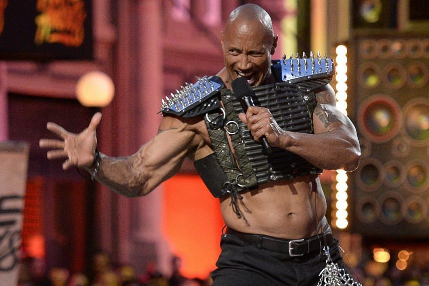Dwayne Johnson takes the stage during the 2016 MTV Movie Awards in Los Angeles, on April 9, 2016.