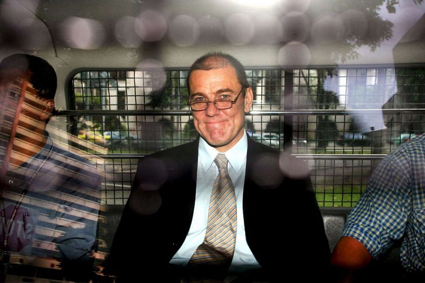British businessman Michael McCrea sitting in a police van leaving the Subordinate Courts. He killed his driver and a Chinese national, and was sentenced to a total of 24 years in jail.