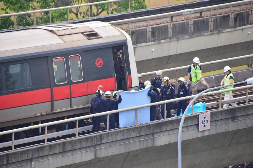 Singapore Civil Defence Force (SCDF) officers at the track accident site near Pasir Ris MRT station on March 22, 2016.