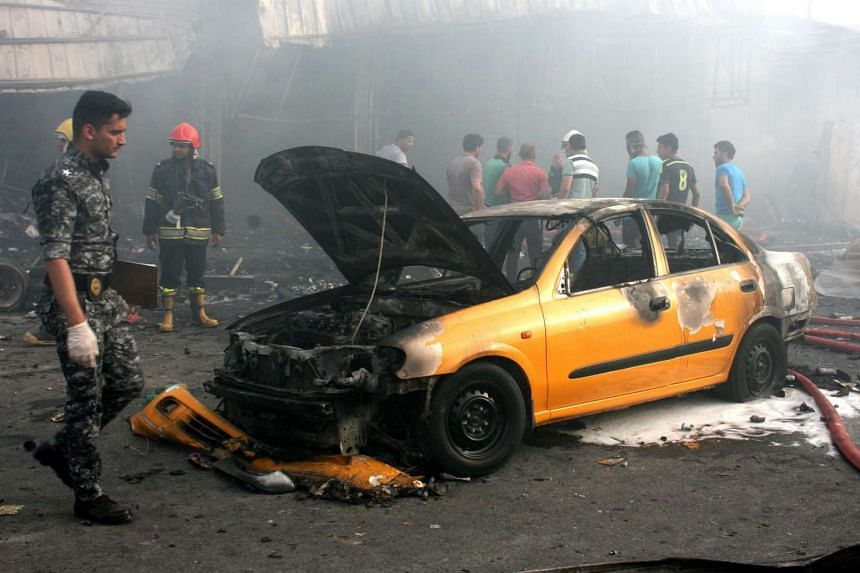 An Iraqi policeman inspects the site of a suicide bomb attack in eastern Baghdad on Monday (April 25).