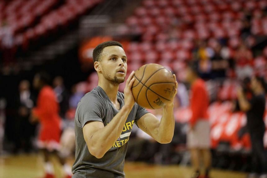 Stephen Curry warms up before game 4 of the first round playoffs in Houston, Texas on Sunday (April 24).