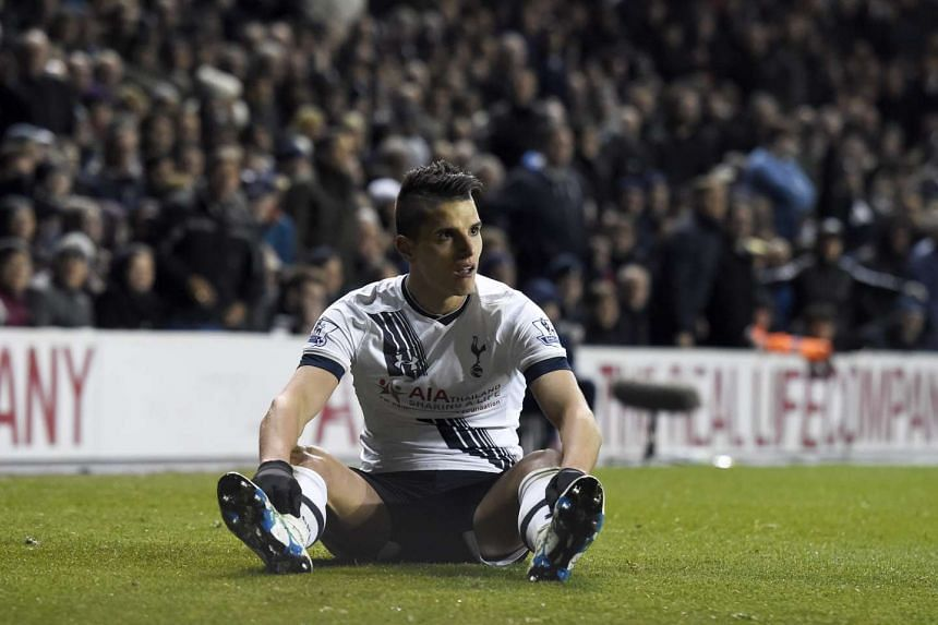 Tottenham's Eric Lamela sits dejected during EPL match against West Bromwich Albion on Monday (April 25).