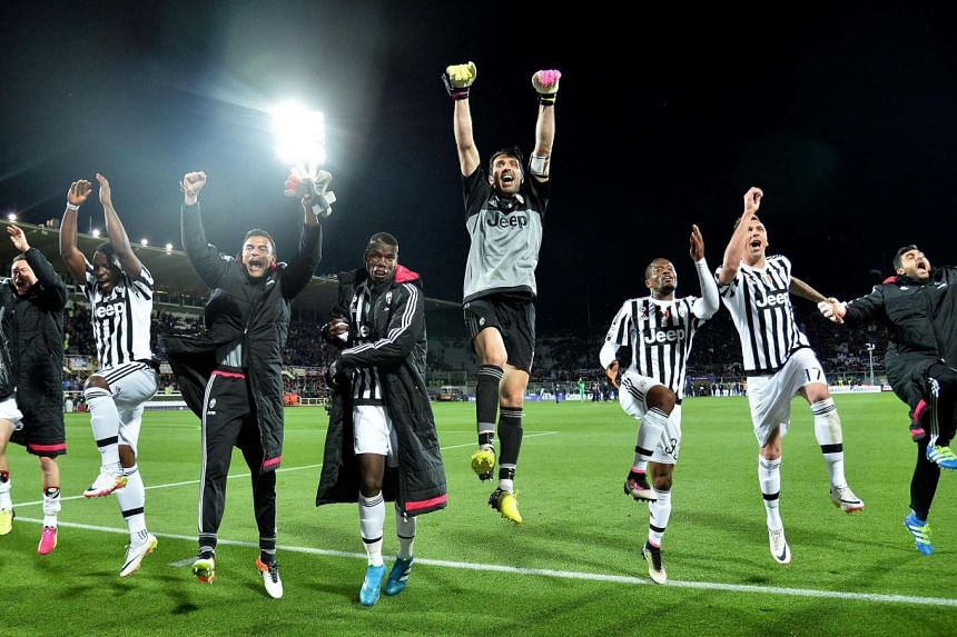 Juventus' players celebrate after beating Fiorentina2-1 in Florence on Sunday (April 24) night.