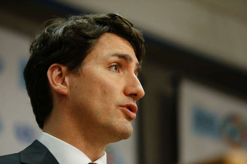 Canadian Prime Minister Justin Trudeau speaks during a press conference.