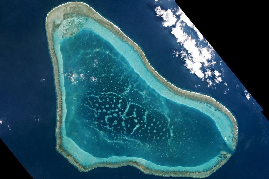 Boats at Scarborough Shoal in the South China Sea are shown in this handout photo provided by Planet Labs, and captured on March 12, 2016.