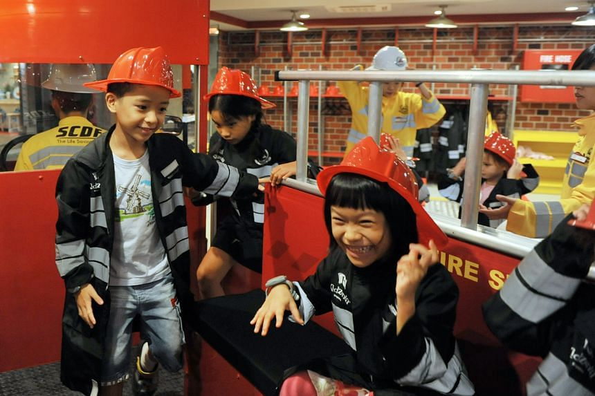 Children getting to role-play firefighters at Kidzania Singapore, which opened at Sentosa on April 12 this year.
