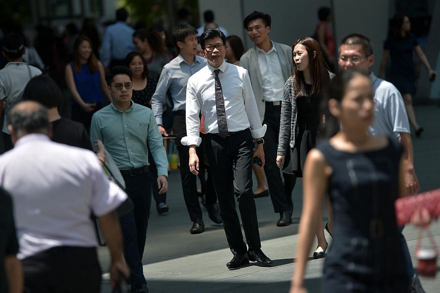 Office workers during lunch hour in the Central Business District at Raffles Place, on Feb 23, 2016.