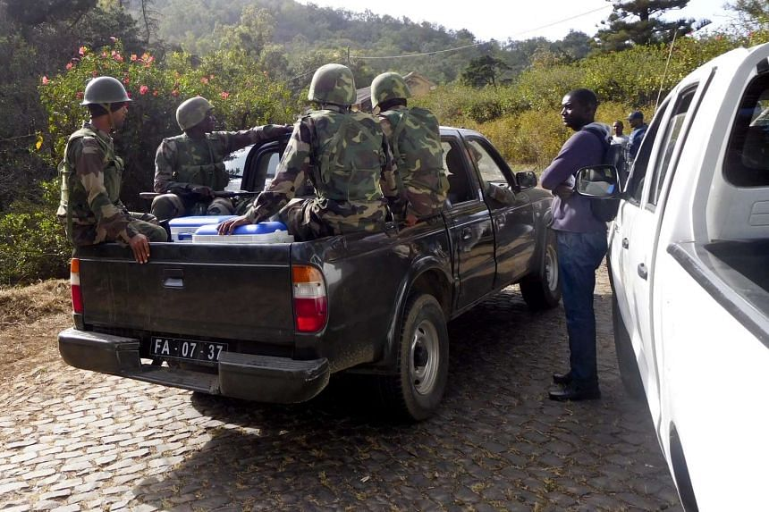 Cape verdian soldiers arrive at the Monte Txota military barracks, on the island of Santiago, Cidade da Praia, Cape Verde, on April 26, 2016, where the bodies of eight soldiers and three civilians were discovered, according to reports.
