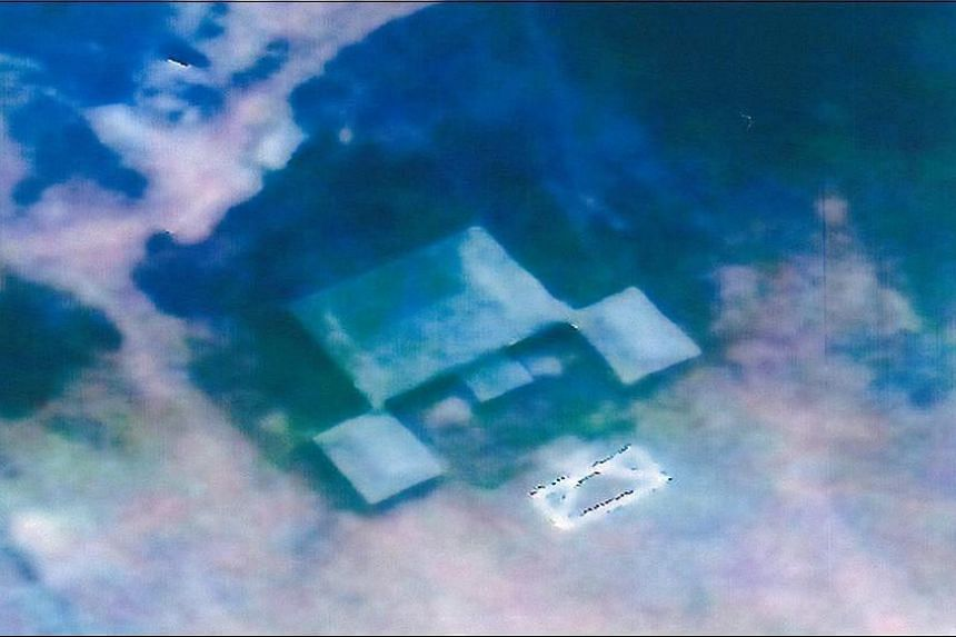 An undated handout image from a South Korean satellite and made available on April 27, 2016 by the National Defence of South Korea showing a target of the replica presidential house (Blue House) in Seoul. South Korea. The South Korean government accu