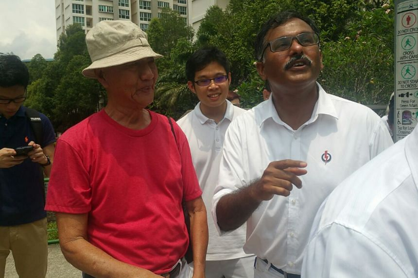 PAP's Murali Pillai greeting a resident as he embarks on his campaign trail.