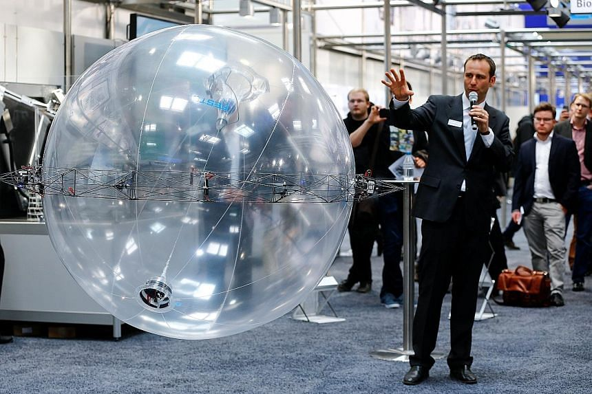 The ultra-light FreeMotionHandling indoor flying object of German automation technology company Festo drawing attention at the Hanover Fair in Germany on Monday. Festo has combined gripping and flying in a single future helium-filled concept object t