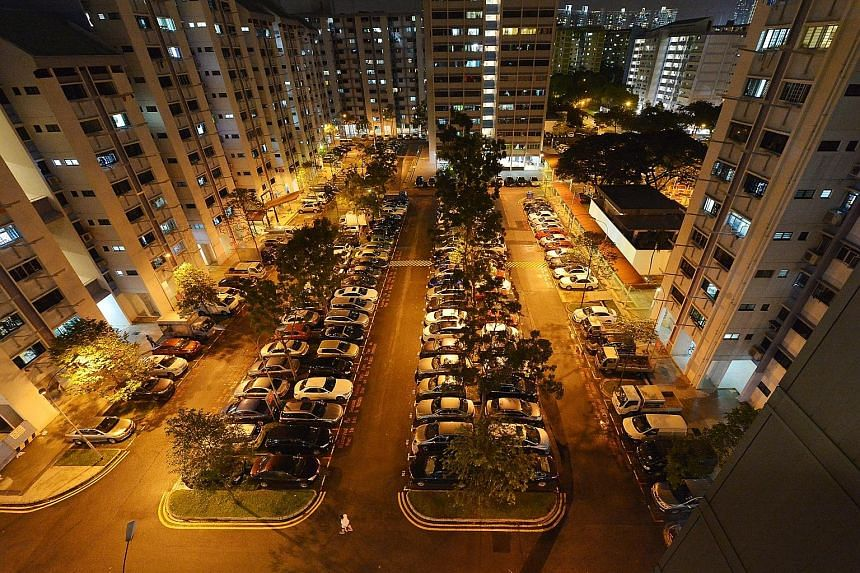 An HDB carpark at night. The Government is obliged to provide roads, because these are vital for business. But it is under no obligation to provide private parking space for cars below market rates, which it is doing now in HDB estates, schools and f
