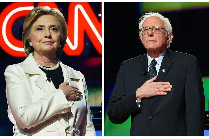 US Democratic presidential candidates Hillary Clinton (left) and Bernie Sanders before a debate in New York on April 14.