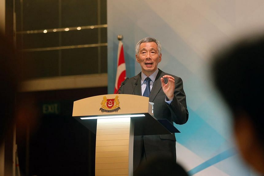Prime Minister Lee Hsien Loong speaking at the Administrative Service's annual promotion event at the Shangri-La Hotel on April 26.