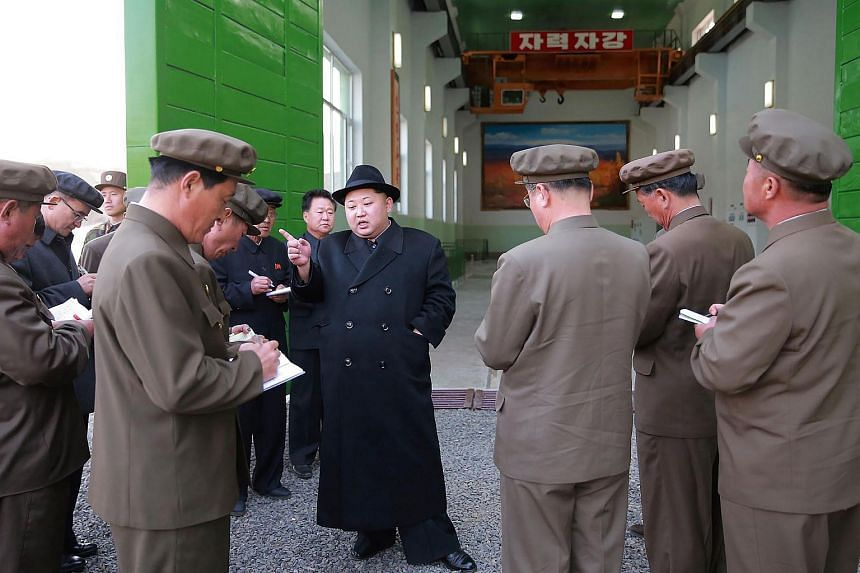 This undated photo released by North Korea's official Korean Central News Agency (KCNA) on April 23, 2016, shows North Korean leader Kim Jong-Un (centre) at the Paektusan Hero Youth Power Station No. 3 in Ryanggang Province.