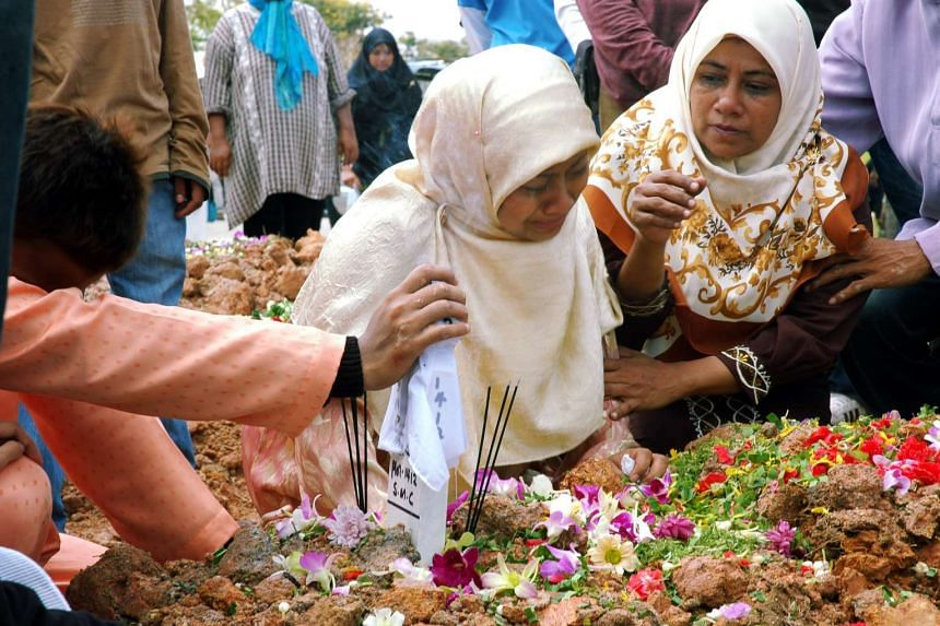 Madam Mastura Kamsir  refusing to leave her daughter Nonoi's side after she was buried.