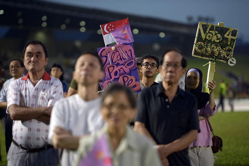 People attend a rally at Bukit Gombak Stadium during the 2015 General Elections.