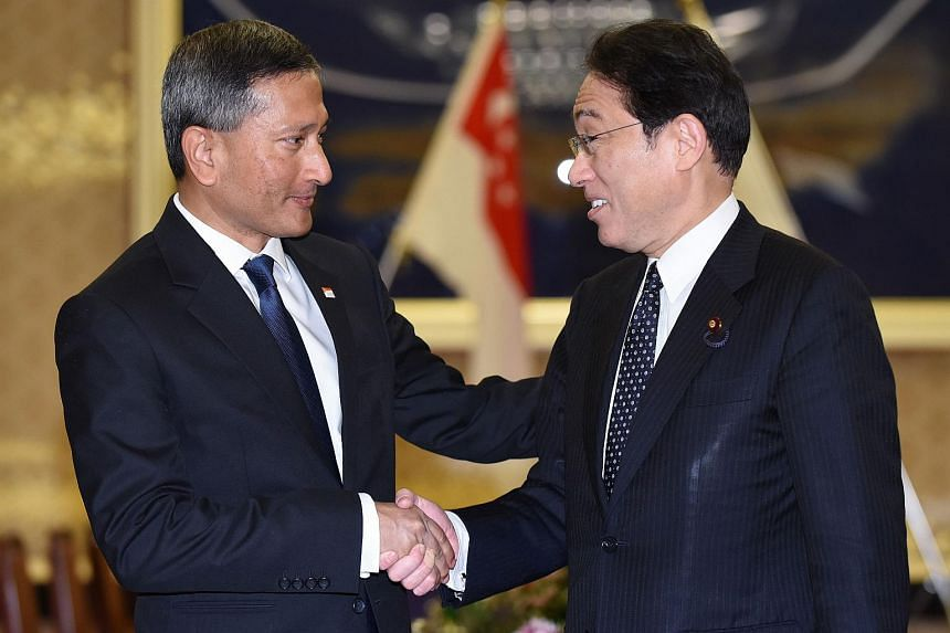 Singapore Foreign Minister Vivian Balakrishnan (left) is welcomed by his Japanese counterpart Fumio Kishida prior to their talks in Tokyo on April 26.