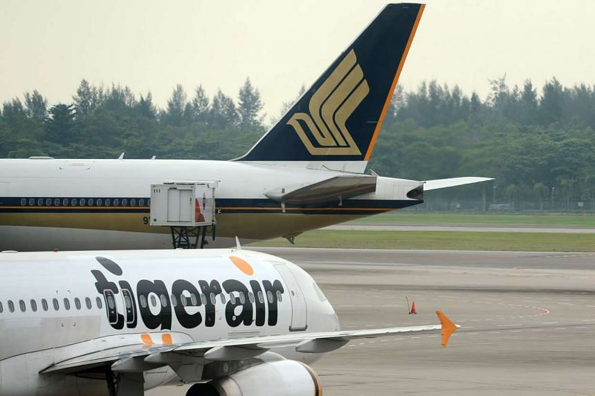 Tigerair and Singapore Airlines (SIA) planes at Changi Airport.