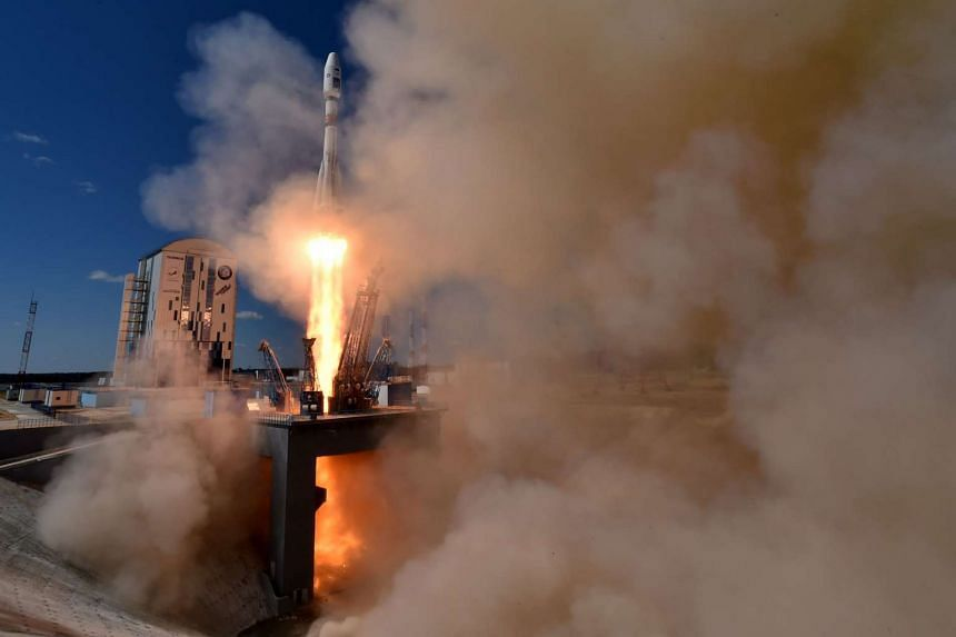 A Russian Soyuz 2.1a rocket carrying Lomonosov, Aist-2D and SamSat-218 satellites begins lift off from the launch pad at the new Vostochny cosmodrome.