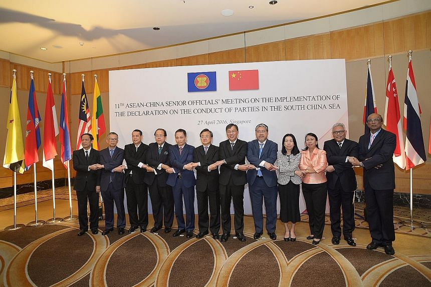 Senior officials from China and Asean who met here yesterday: (from left) Laos' Minister in the Government's Office Alounkeo Kittikhoun; Malaysia's Foreign Affairs Ministry Secretary-General Othman Hashim; Myanmar's Foreign Affairs Ministry Permanent