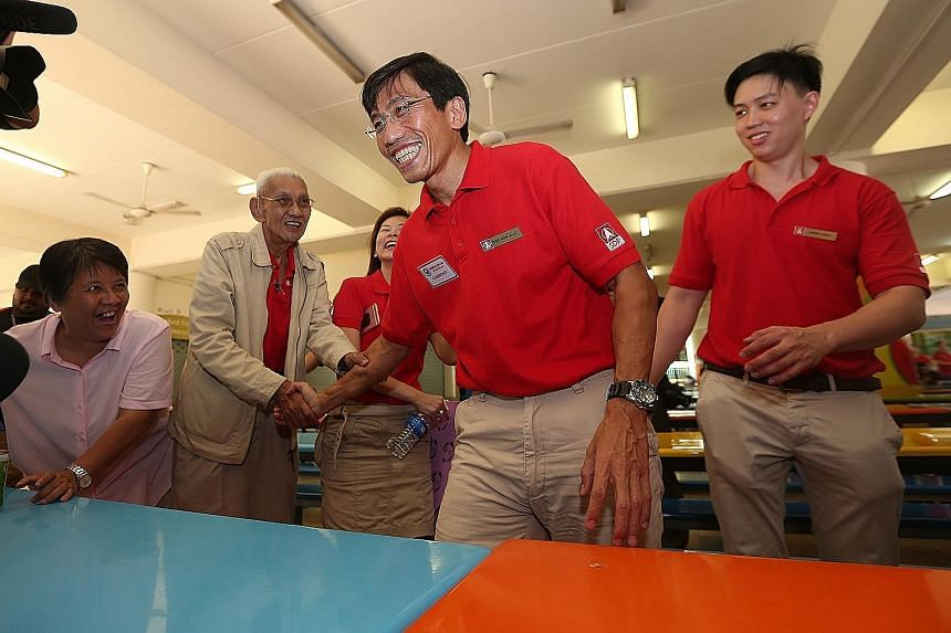 """Dr Chee (centre) after a press conference yesterday at Keming Primary School, the nomination centre. Earlier, he said that SDP will make Bukit Batok a model town and """"the envy of Singapore"""". At the conference, he said that apart from rallies, he will"""