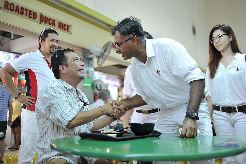 Mr Murali meeting a Bukit Batok resident on Nomination Day yesterday. He says the groups he is most intent on helping are the jobless, the elderly and children from lower-income or broken homes.