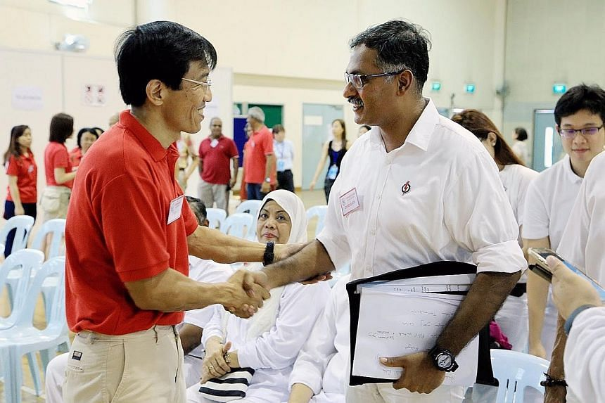 SDP chief Chee Soon Juan greets PAP's Mr Murali Pillai at the nomination centre at Keming Primary School. Both candidates kicked off the race yesterday with promises to make the constituency shine but a disagreement arose on how they would do so.