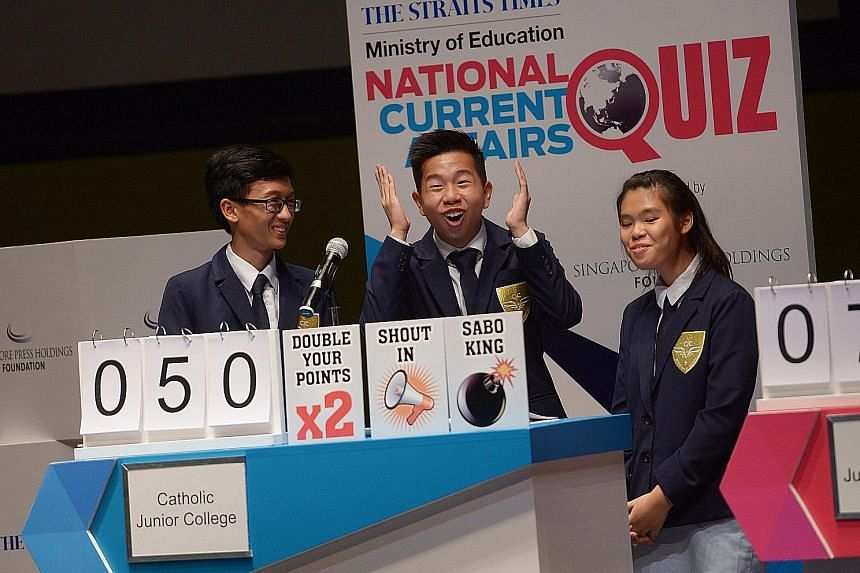 CJC students (from left) Andi, Jose and Shi Yen tackling a question during the third round of the Big Quiz before emerging victorious yesterday.