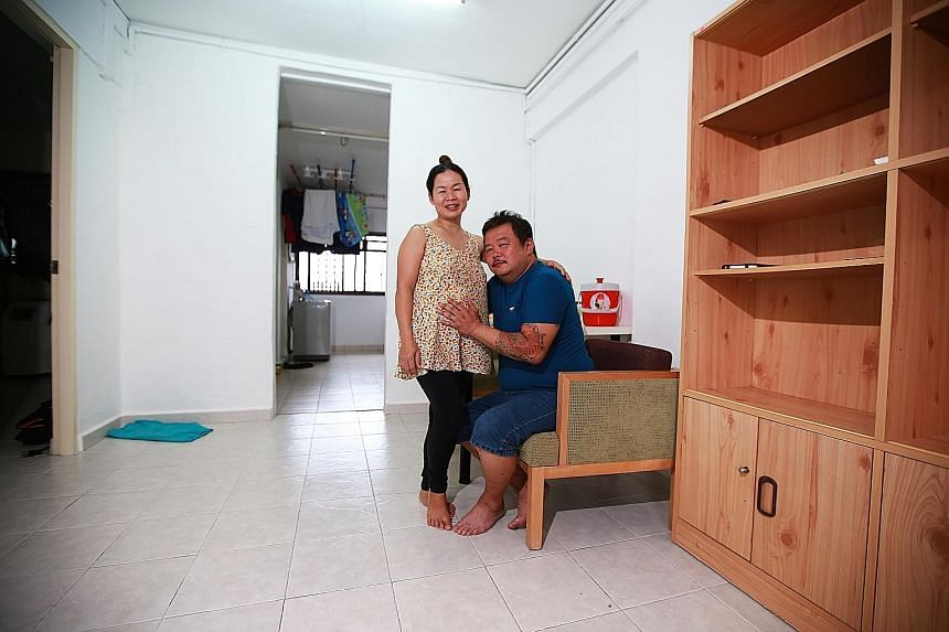 Rice delivery man Mr Ong and his wife, Ms Nguyen, in their temporary two-room HDB rental flat. ST readers have offered to donate items like beds and fridges as well as baby cots and other necessities such as nappies to help them in their new life.
