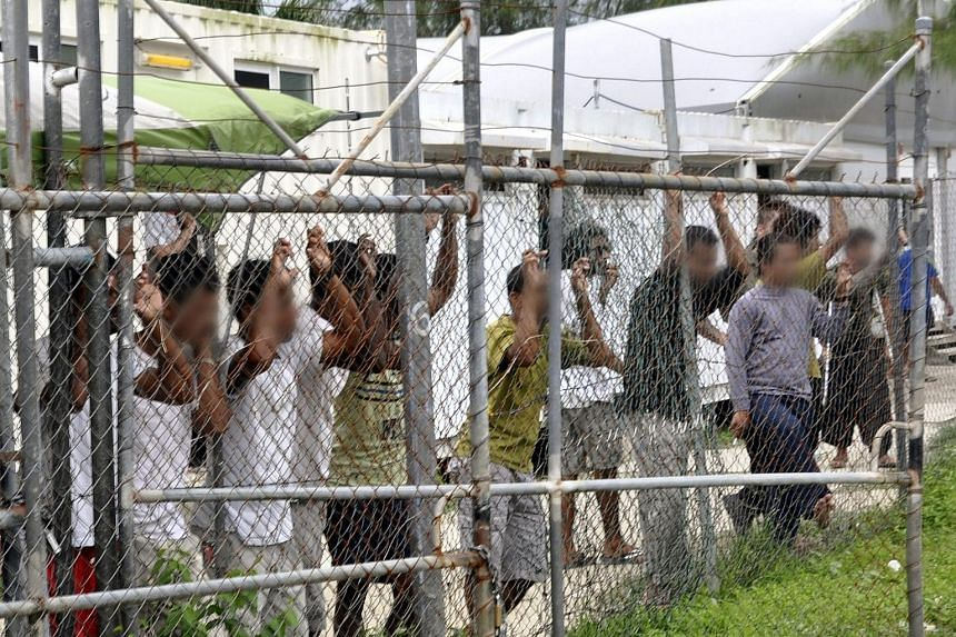 Asylum seekers fenced in at the Australian-funded regional processing centre on Manus island in Papua New Guinea. The PNG Supreme Court on Tuesday ordered the closure of the camp, saying that holding the refugees there was both unconstitutional and i