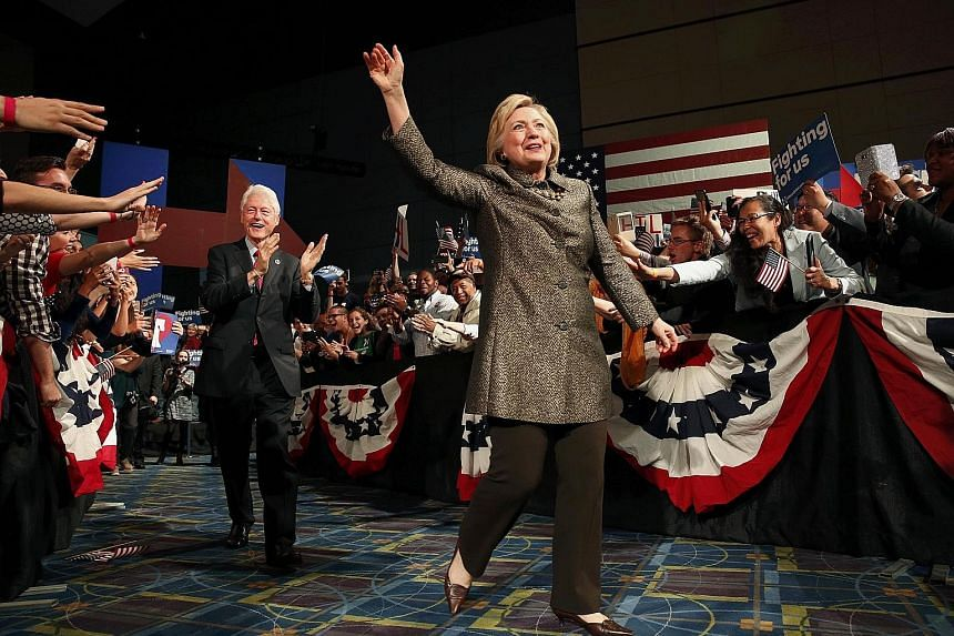 """Mrs Clinton waving to the audience as she arrived with her husband, former United States president Bill Clinton, to speak to supporters during her five-state primary night rally in Pennsylvania on Tuesday. Mr Trump claims the """"only card she has is th"""