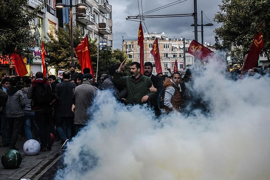 Anti-riot police using tear gas on Tuesday to disperse demonstrators during a protest at Kadikoy district in Istanbul against a call for the country to adopt a religious Constitution.