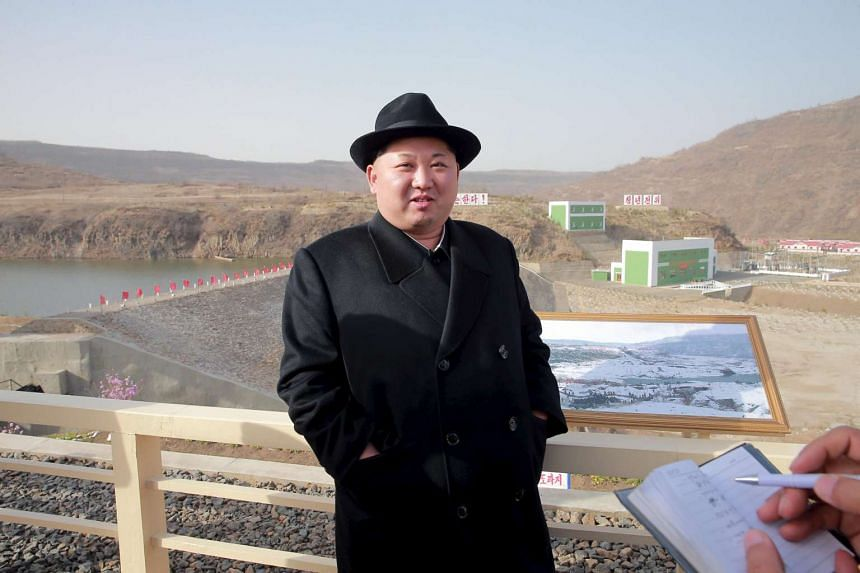 North Korean leader Kim Jong Un visits the Paektusan Hero Youth Power Station No. 3 in this undated photo released by North Korea's KCNA.