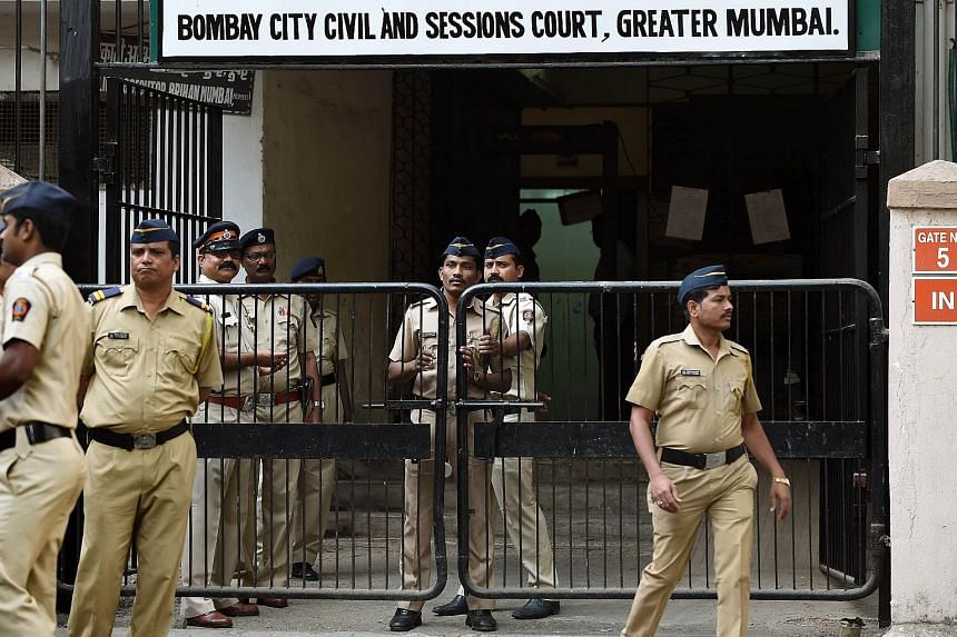 Indian police standing guard outside the sessions court in Mumbai on Feb 8.