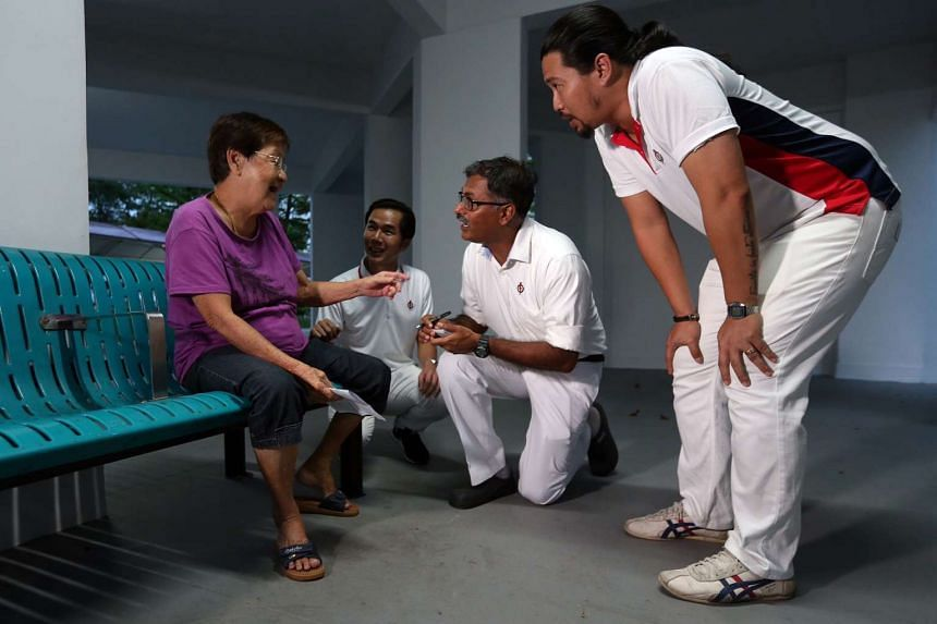 PAP candidate Murali Pillai (centre) greets residents in Bukit Batok Central on April 28, 2016.