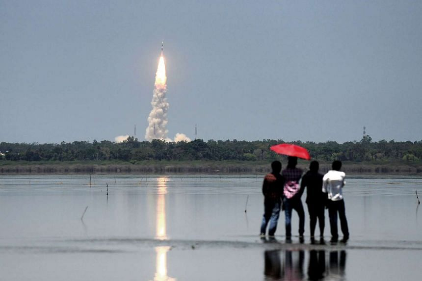 Bystanders look on as Indian Space Research Organisation's (ISRO) navigation satellite IRNSS-1G is launched from Sriharikota on Thursday (April 28).