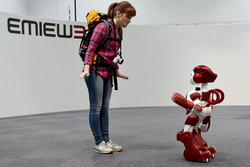 Japanese electronics giant Hitachi's EMIEW3 customer service and guidance robot during a demonstration in Tokyo on April 8.